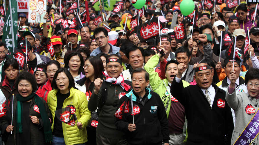 Demonstrators shout slogans and march in protest against the polices of Taiwan's China-friendly President Ma Ying-jeou in Taipei, Taiwan, January 13, 2013.