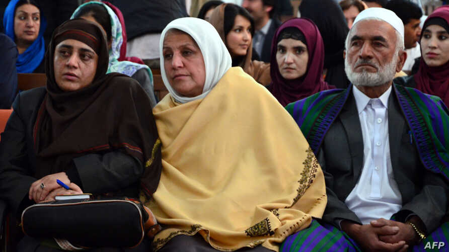 Relatives of Afghan woman, 27-year-old Farkhunda, who was beaten to death by a mob, attend a hearing at a court in Kabul on May 6, 2015. Four Afghan men were sentenced to death for the savage lynching of a woman falsely accused of blasphemy, a landma...