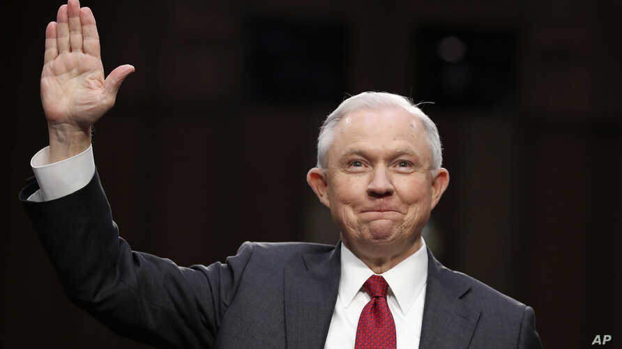 Attorney General Jeff Sessions smiles after being sworn-in on Capitol Hill in Washington, June 13, 2017.