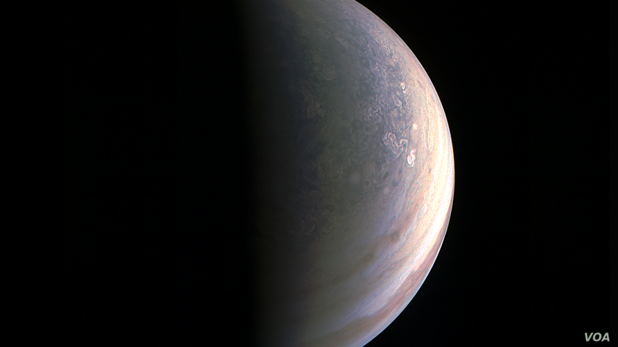 NASA's Juno spacecraft captured this view as it closed in on Jupiter's north pole, about two hours before closest approach on Aug. 27, 2016.
