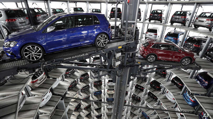 FILE - Volkswagen cars are lifted inside a delivery tower of the company in Wolfsburg, Germany, March 14, 2017.