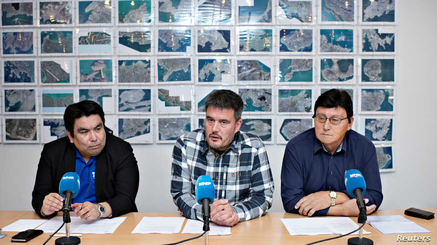 Vittus Qujaukitsoq the leader of Nunatta Qitornai party, from left, Kim Kielsen, chairman of Siumut, and Siverth K. Heilmann, the leader of Atassut party, are pictured in Nuuk, Greenland, Oct. 2, 2018.