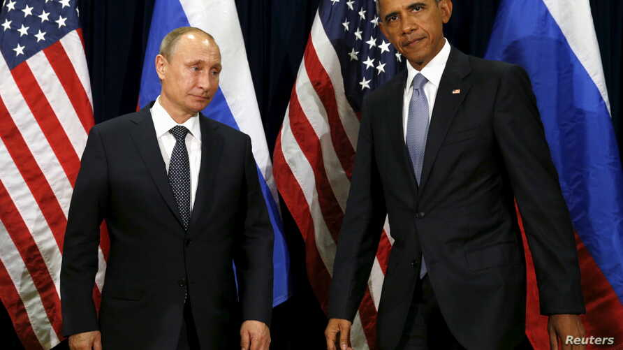 U.S. President Barack Obama and Russian President Vladimir Putin meet at the United Nations General Assembly in New York September 28, 2015. REUTERS/Kevin Lamarque  - RTX1SYBN