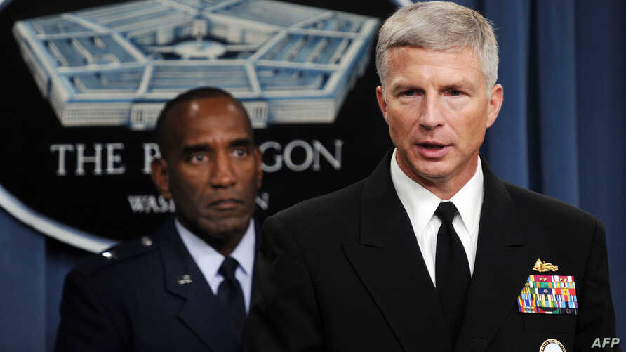 FILE - Rear Admiral Craig Faller, right, U.S. Navy Recruiting Command and Brig. General Alfred Stewart, U.S. Air Force Recruiting Service brief the media, Oct. 13, 2009, at the Pentagon in Washington.