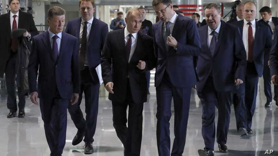 Russian President Vladimir Putin, center, visits a new power plant in Crimea, part of Moscow's efforts to upgrade the region's infrastructure in Sevastopol, Crimea, March 18, 2019. (Mikhail Klimentyev, Sputnik, Kremlin Pool Photo via AP)