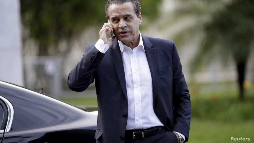 Brazilian Minister of Tourism Henrique Alves, pictured in December 2015 in Brasilia, is the third minister to resign in a month in connection with the Petrobras graft probe.