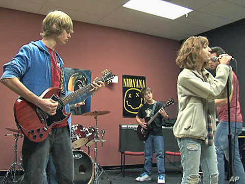 Students at the School of Rock program perform in a band as they receive instruction, March 2011