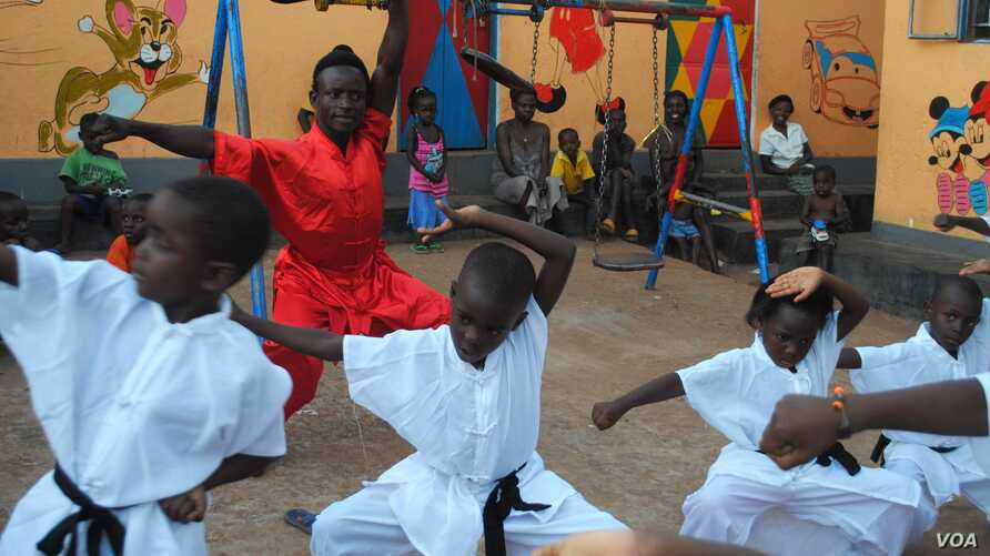 Children learn Kung Fu in hopes of becoming an action star, Kampala, Uganda, Oct. 9, 2014.
