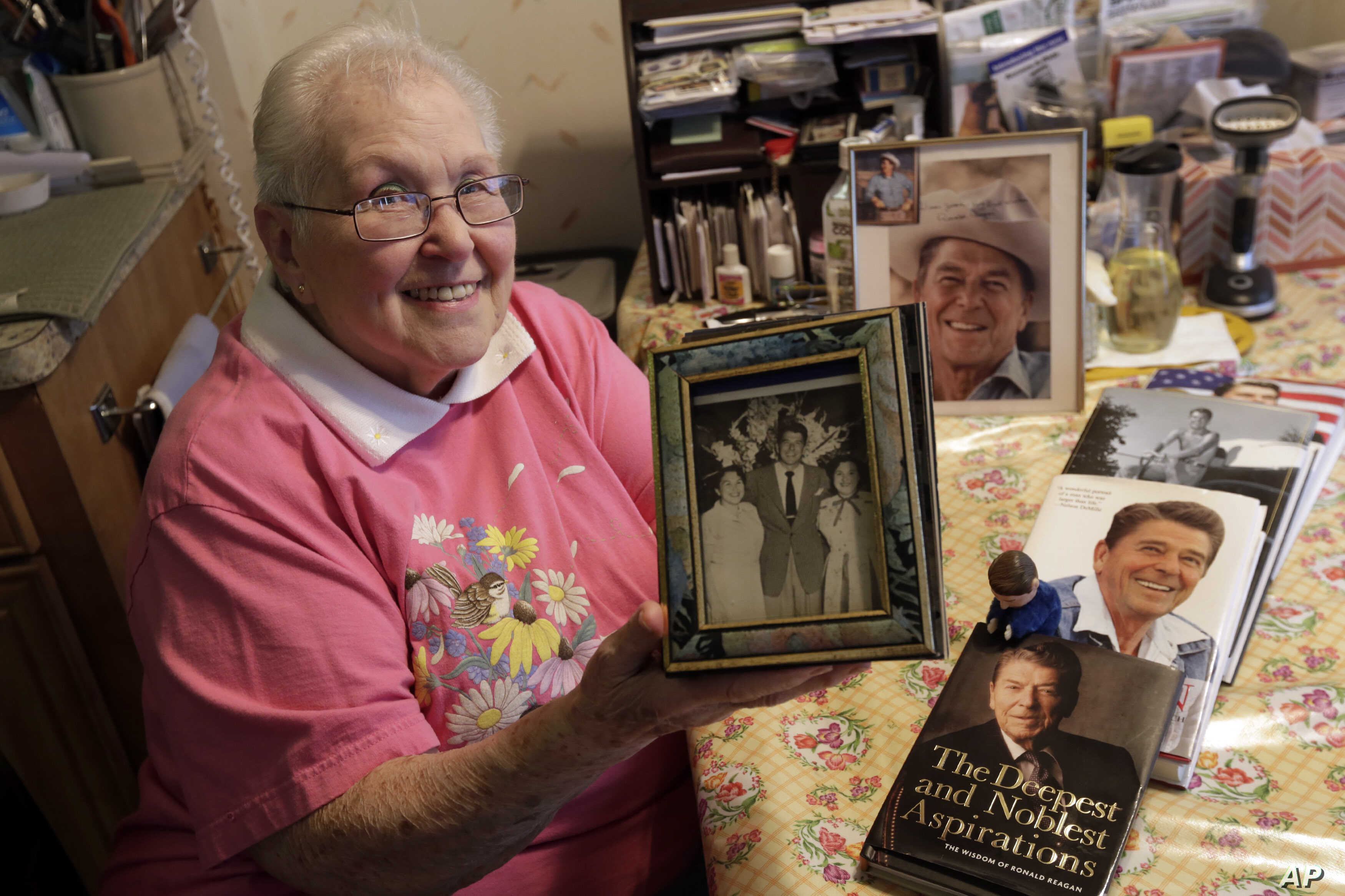 FILE - Former Ronald Reagan International Fan Club president Zelda Multz, 89, poses for photos with Reagan memorabilia in her apartment in the Brooklyn borough of New York, April 1, 2016.