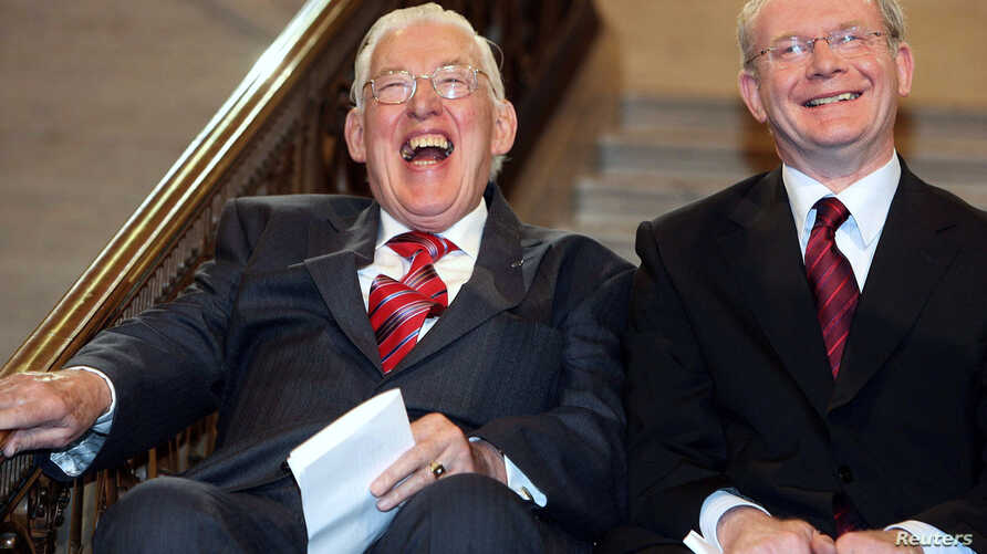File photograph shows Northern Ireland's new first minister Ian Paisley (L) and deputy first minister Martin McGuinness smiling after being sworn in at a ceremony at Stormont, Belfast May 8, 2007.