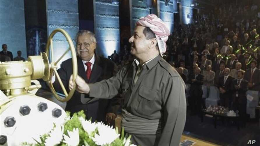 KRG president Massud Barzani, right, and Iraqi President Jalal Talabani open a ceremonial valve during an event to celebrate the start of oil exports from the autonomous region of Kurdistan, Irbil, Iraq, June 1, 2009.