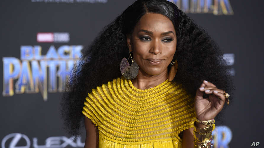 "Angela Bassett, a cast member in ""Black Panther,"" poses at the premiere of the film at the El Capitan Theatre, Jan. 29, 2018, in Los Angeles."