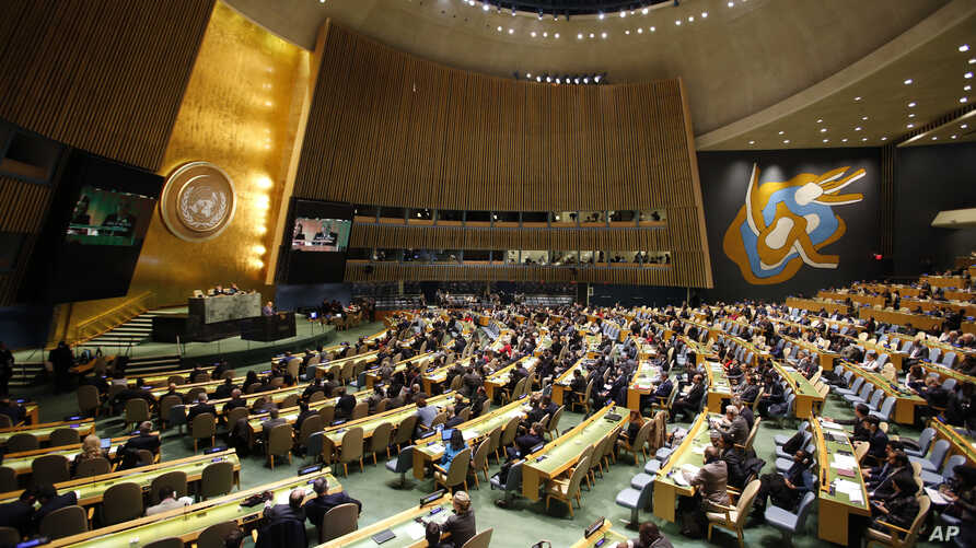 People gather at the General Assembly, prior to a vote, Dec. 21, 2017, at United Nations headquarters in New York.