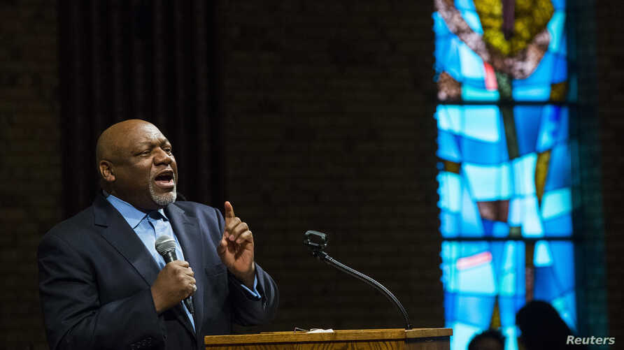 Pastor Tommie Pierson preaches during a Thanksgiving service that discussed the community's reaction to developments in the Michael Brown case in Ferguson, Missouri,  Nov. 27, 2014.