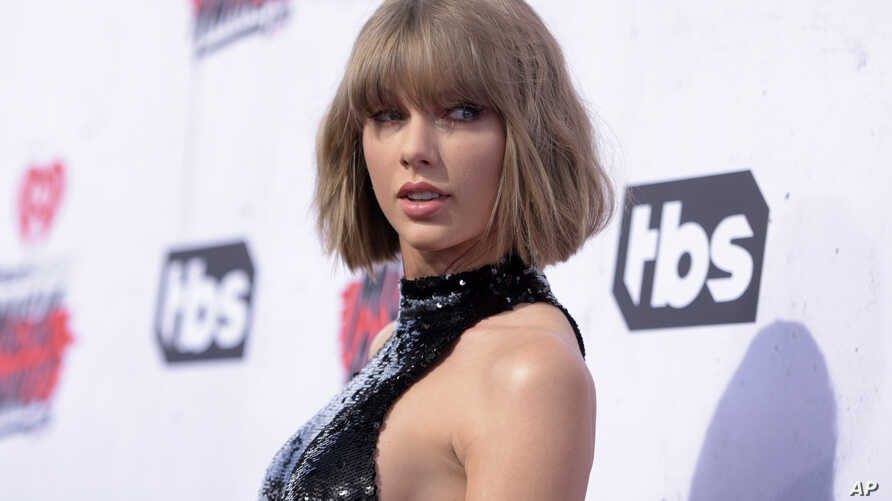 Taylor Swift arrives at the iHeartRadio Music Awards at The Forum on April 3, 2016, in Inglewood, Calif.