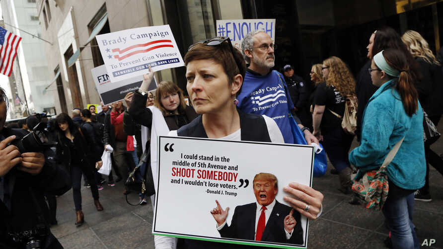 "Protesters, organized by The Brady Campaign to Prevent Gun Violence, stage a ""die-in"" in front of Trump Tower, the residence of Republican presidential candidate Donald Trump, March 16, 2016, in New York."