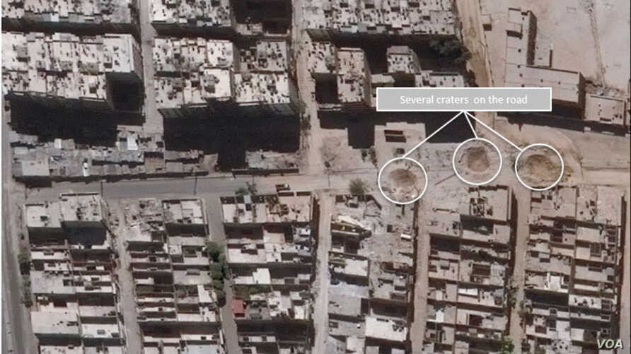 Road damage and craters in Sha'ar District of Aleppo, Syria. (Satellite image Produced by UNITAR-UNOSAT)