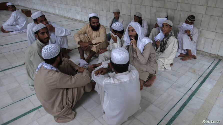 Pakistani religious students and teachers attend a discussion session at the Ganj Madrassa in Peshawar, Aug. 21, 2013.