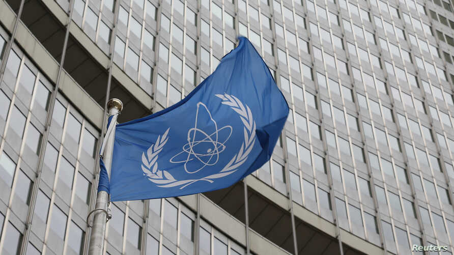 The flag of the International Atomic Energy Agency (IAEA) flies in front of its headquarters in Vienna, Austria, Jan.15, 2016.