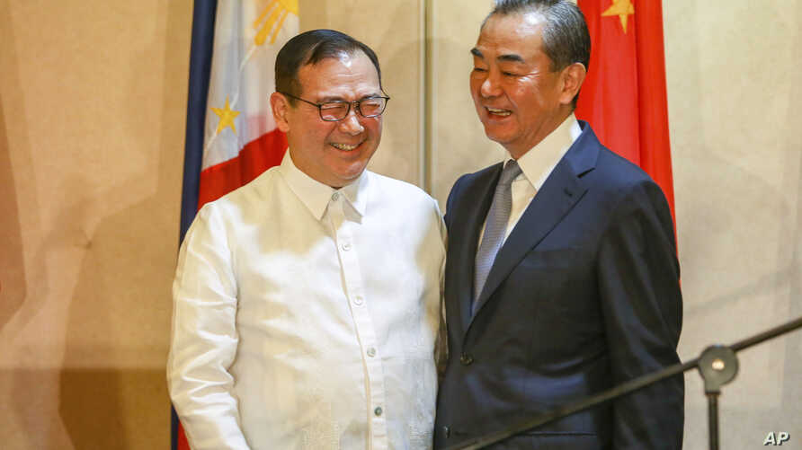 Philippine Foreign Affairs Secretary Teodoro Locsin Jr., left, and visiting Chinese Foreign Minister Wang Yi are engaged in a light moment during the latter's courtesy call in Davao city, in southern Philippines, Oct. 29, 2018.