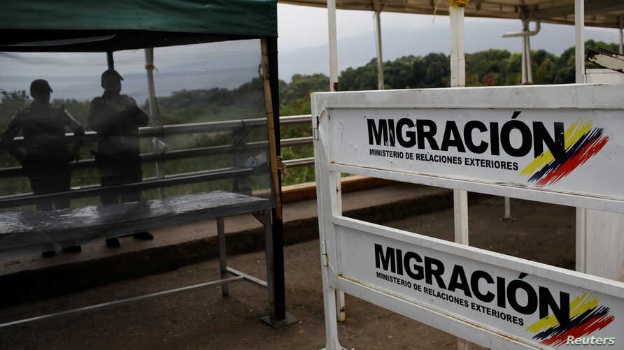 The Colombian migration logo is seen on a fence on the Simon Bolivar cross-border bridge between Venezuela and Colombia, in Cucuta, Colombia, Feb. 27, 2019.