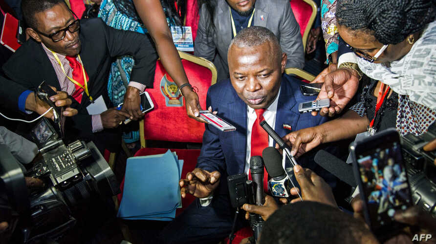 "Vital Kamerhe, President of the opposition Citizen Front (Front Citoyen, UNC) party (C) speaks to the media during the opening of a Congolese ""National Dialogue"" in the Democratic Republic of Congo's capital Kinshasa, Sept. 1, 2016."
