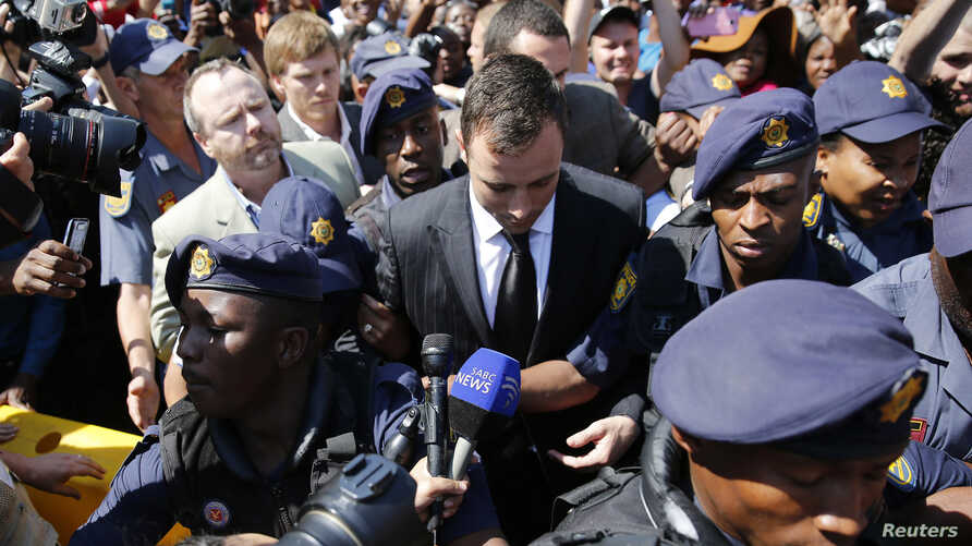 Olympic and Paralympic track star Oscar Pistorius leaves the North Gauteng High Court in Pretoria, Sept, 12, 2014.