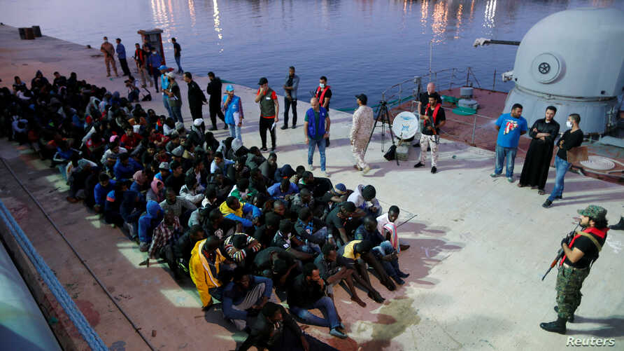 Migrants arrive at a naval base after they were rescued by Libyan Navy, in Tripoli, Libya, Nov. 4, 2017.