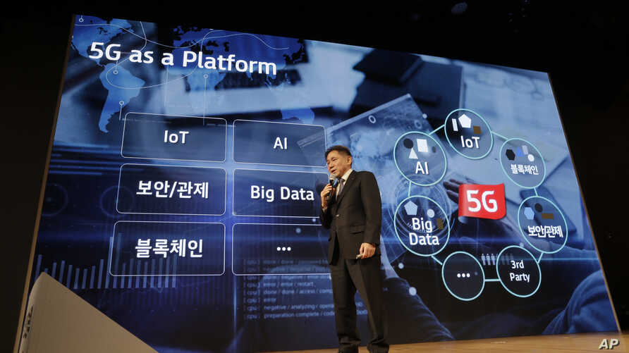 FILE - Lee Pil-jae, Vice President at KT Corp., speaks during a press conference on 5G service at its the headquarters in Seoul, South Korea.