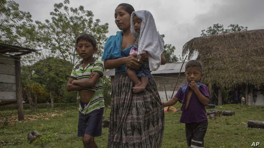 Claudia Maquin, 27, walks with three of her children as they leave the home of Domingo Caal Chub, Claudia's father-in-law, in Raxruha, Guatemala, Dec. 15, 2018. Maquin's 7-year-old daughter, Jakelin CaalMaquin, died in a Texas hospital Dec. 8.