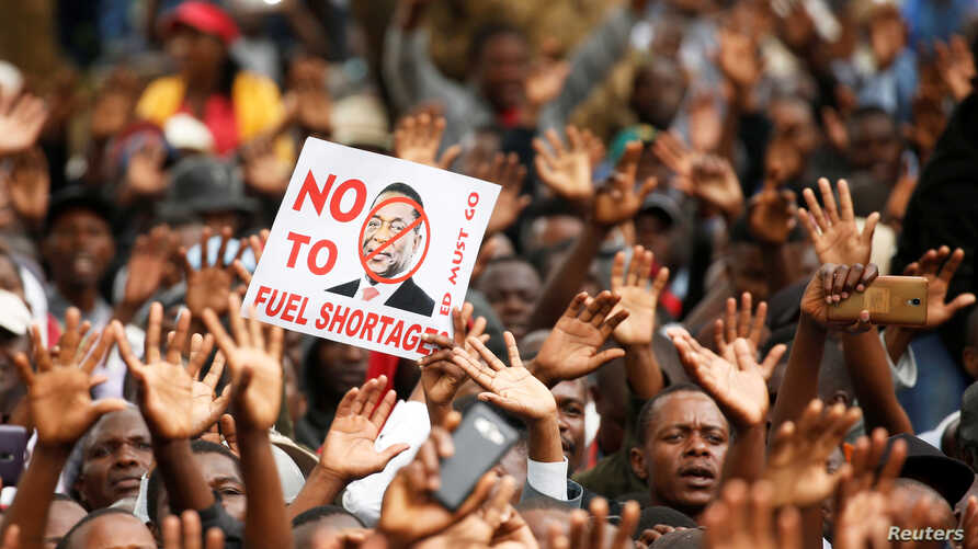 Supporters of the opposition Movement For Democratic Change (MDC) party take part in anti-government protests over economic hardships in Harare, Zimbabwe, Nov. 29, 2018.