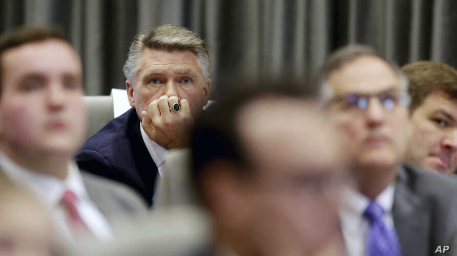 Mark Harris listens to the public evidentiary hearing on the 9th Congressional District investigation, Feb. 18, 2019, at the North Carolina State Bar in Raleigh, N.C.
