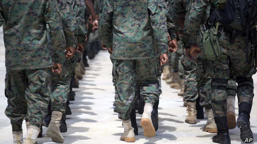 Members of Haiti's new national military force march during training at a former U.N. base in Gressier, Haiti, April 11, 2017. While it's easy to find citizens who strongly support reconstituting a Haitian army, the idea alarms those who vividly reme