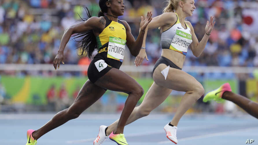 Jamaica's Elaine Thompson, left, and Germany's Gina Luckenkemper compete in a women's 200-meter heat during the athletics competitions of the 2016 Summer Olympics at the Olympic stadium in Rio de Janeiro, Brazil,  Aug. 15, 2016.