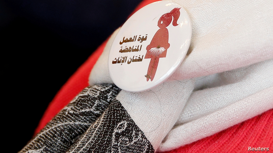 "A badge reads ""The power of labor aginst FGM"" is seen on a volunteer during a conference on International Day of Zero Tolerance for Female Genital Mutilation (FGM) in Cairo, Egypt February 6, 2018."