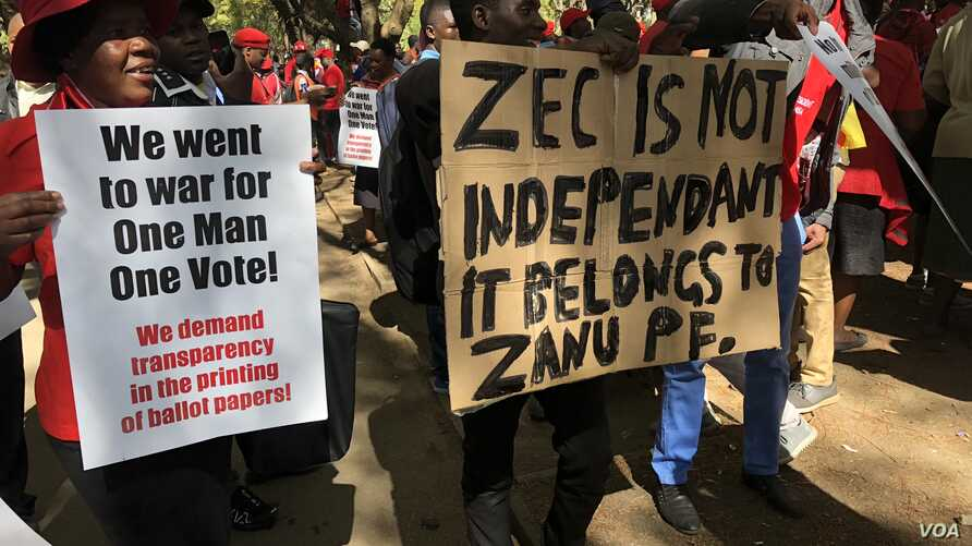 Members of the Movement for Democratic Change Alliance (MDC) protest against the Zimbabwe Electoral Commission, which they accuse of plotting to rig for ruling ZANU-PF party, in Harare, July 11, 2018.