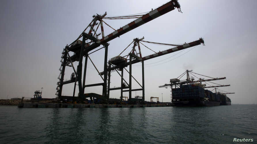 FILE - A view of the container terminal at the southern Yemeni port of Aden. On Thursday, July 26, Saudi Energy Minister Khaled Faleh was quoted by a Saudi TV station as saying the state-owned Saudi oil giant Aramco was temporarily stopping oil shipm