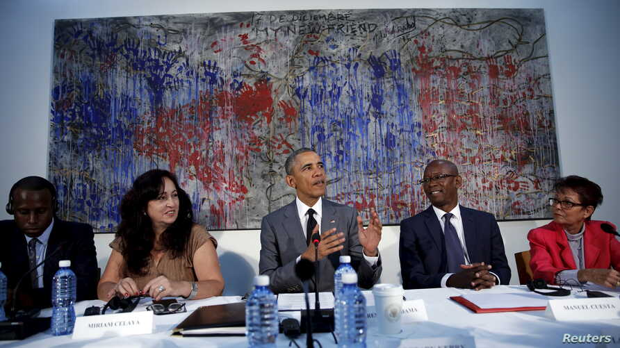 "U.S. President Barack Obama attends a meeting with Cuban dissidents at the U.S. embassy in Havana, Cuba, March 22, 2016. On the wall behind Obama is a painting, ""My New Friend,"" donated to the embassy by Michel Mirabal, a Cuban artist."