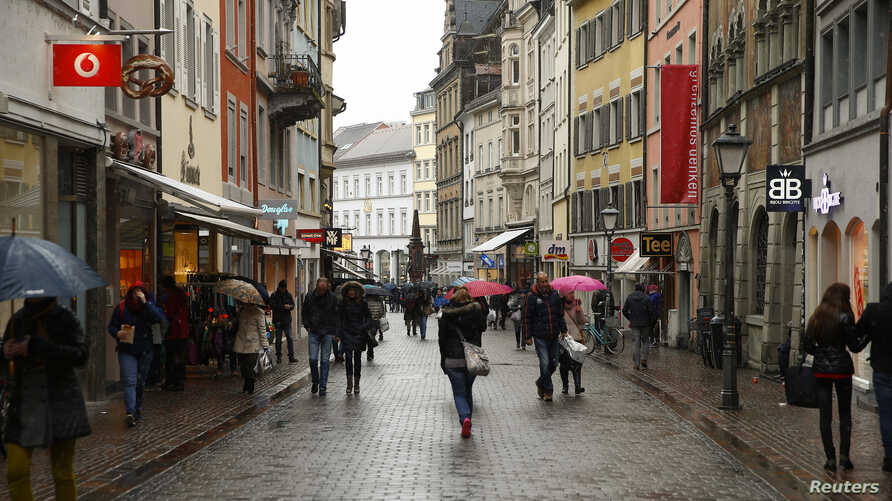 FILE - People walk along a street in the southern German town of Konstanz, Jan. 17, 2015.