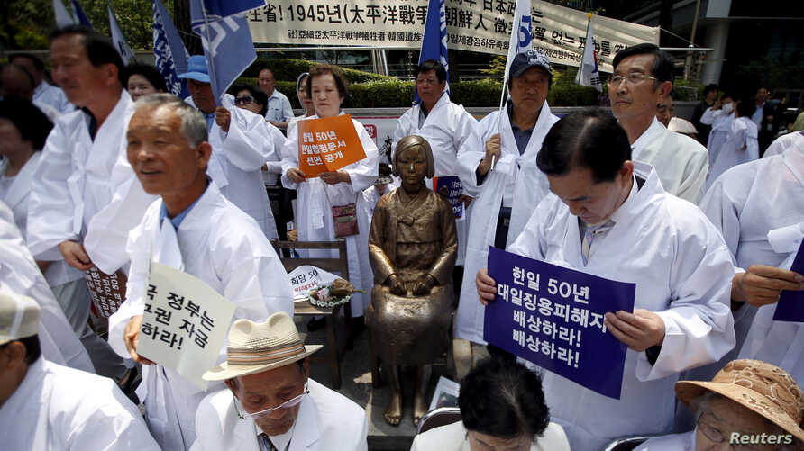 FILE - Descendants of Koreans who were conscripted to the Japanese imperial army or recruited for forced labor under Japan's colonization attend an anti-Japan rally in front of the Japanese embassy in Seoul, South Korea, June 22, 2015.