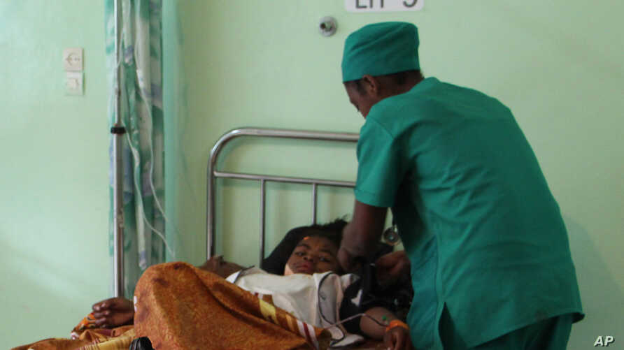 A person is treated, at a public hospital in Antananarivo, Madagascar on June 27, 2016, a day after an explosion at a stadium.