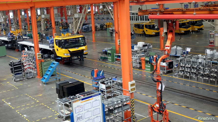 FILE - A factory floor of XCMG Group is seen in Xuzhou, Jiangsu province, China, Aug. 14, 2015. Two years after China unveiled a sweeping plan to rebuild Silk Road trade links with Europe and Asia, machinery maker XCMG Group has opened a factory in U...