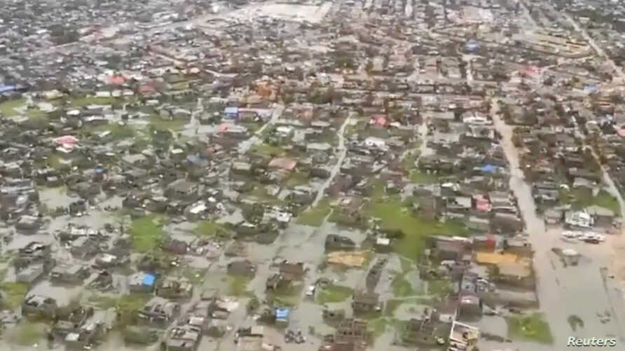 Helicopter footage shows flooding and damage after Cyclone Idai in Beira, Mozambique, March 17, 2019 in this image taken from a social media video on March 18, 2019. (International Federation Of Red Cross And Red Crescent Societies)