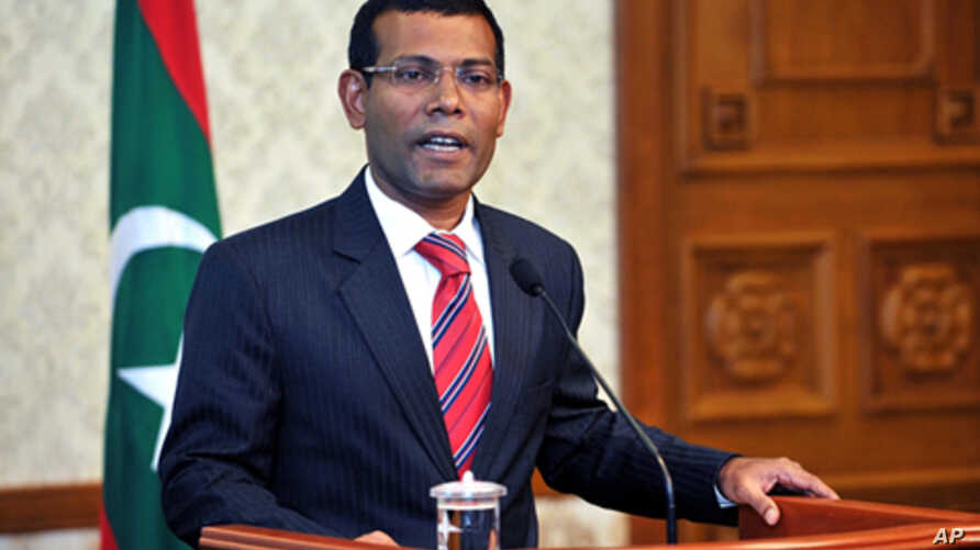 Maldives'  first democratically elected president Mohamed Nasheed announces his resignation in a nationally televised address in Male, Maldives, February 7, 2012.
