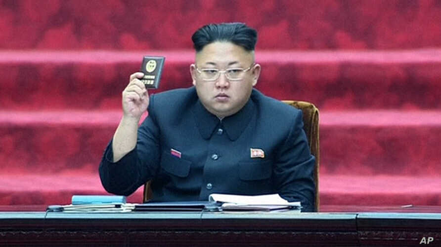 In this Wednesday, April 9, 2014 image made from video, North Korean leader Kim Jong Un holds up parliament membership certificate during the Supreme People's Assembly in Pyongyang, North Korea