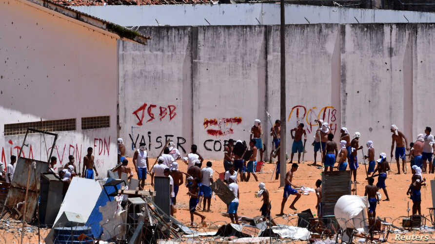 Inmates are seen during an uprising at Alcacuz prison in Natal, Rio Grande do Norte state, Brazil, Jan. 19, 2017.