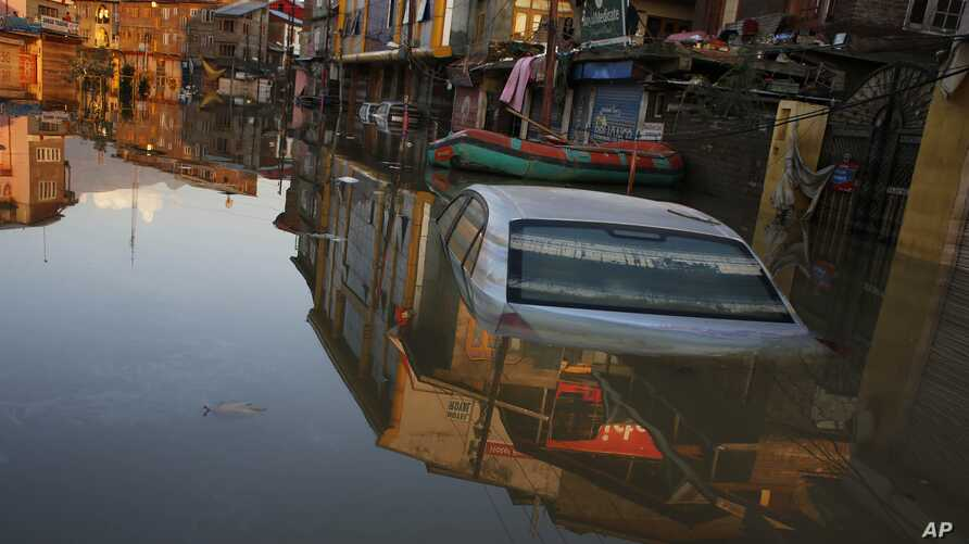 A car is partially submerged in a flooded neighborhood of Srinagar, Indian-controlled Kashmir, Sept. 15, 2014.