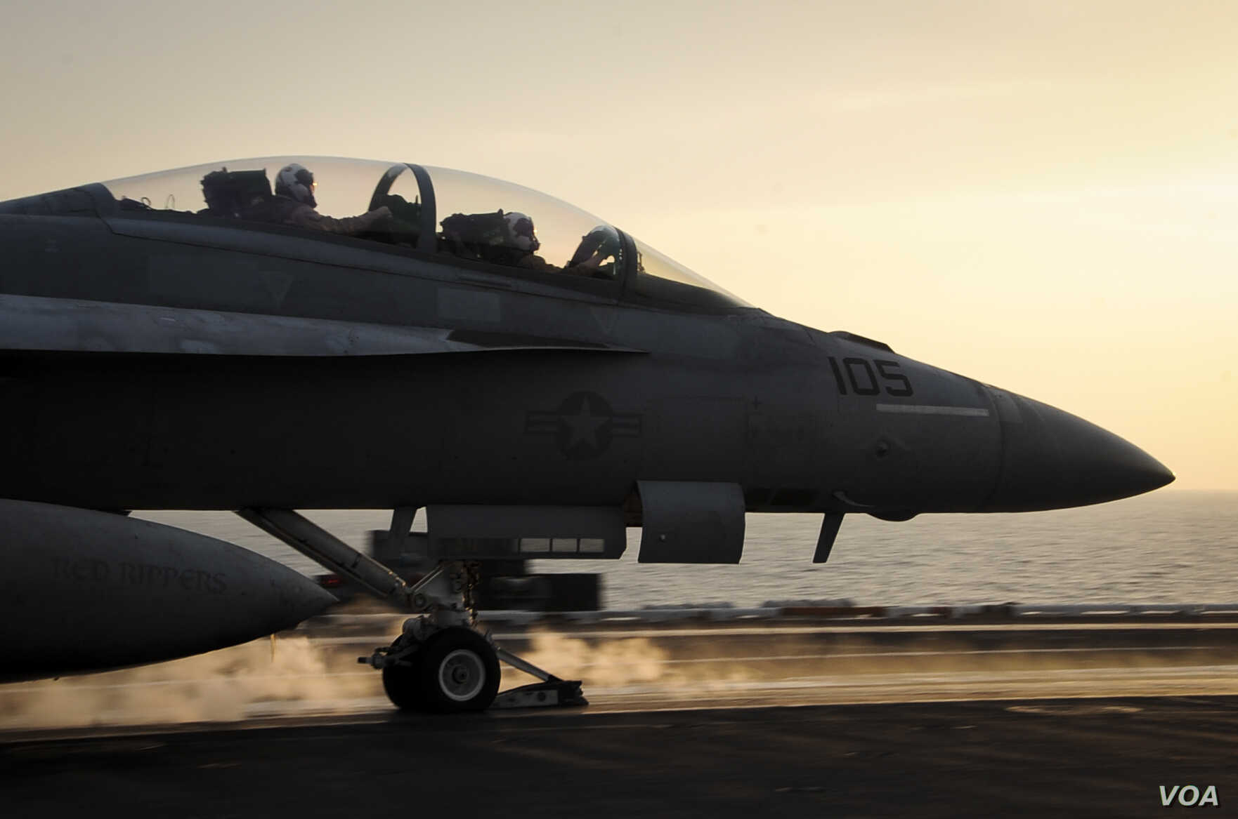 An F/A-18F Super Hornet launches from the flight deck of the aircraft carrier USS Theodore Roosevelt which is supporting strike operations in Iraq and Syria, on Oct. 10, 2015.