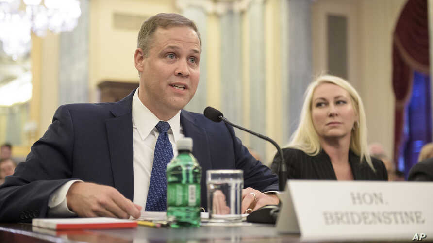 FILE - Rep. James Bridenstine, R-Okla., administrator of NASA, testifies at his nomination hearing before the Senate Committee on Commerce, Science, and Transportation in Washington, Nov. 1, 2017. On Wednesday,Bridenstine says NASA is talking with pr