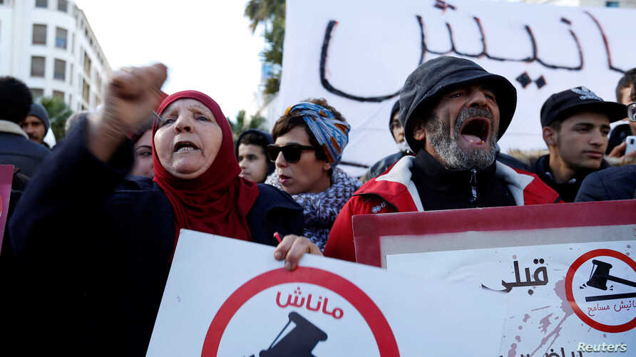 Protesters shout slogans against rising prices and tax increases in Tunis, Tunisia, Jan. 13, 2018.